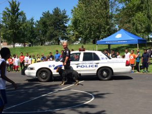 Students line up to greet the police dog.
